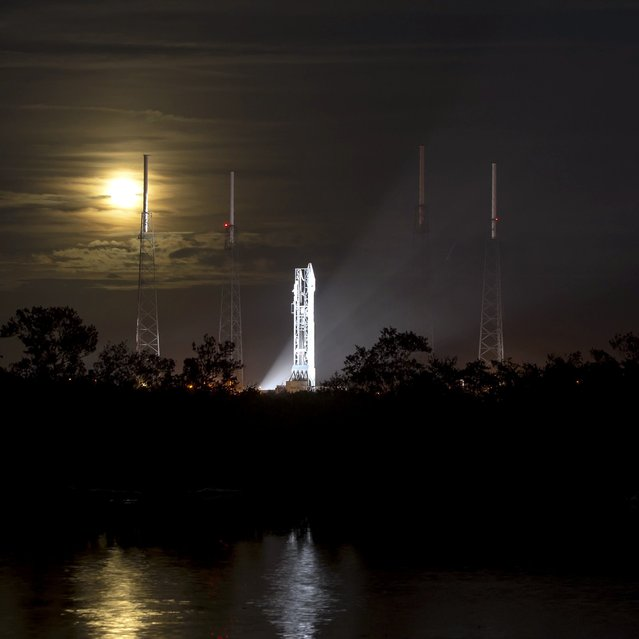 This photo provided by NASA shows a full moon rising behind the United Launch Alliance Atlas V rocket with NASA's Mars Atmosphere and Volatile Evolution (MAVEN) spacecraft onboard at the Cape Canaveral Air Force Station Space Launch Complex 41, Sunday, Nov. 17, 2013, Cape Canaveral, Florida. NASA's next Mars-bound spacecraft, the Mars Atmosphere and Volatile Evolution, or MAVEN, is the first spacecraft devoted to exploring and understanding the Martian upper atmosphere. (AP Photo/NASA, Bill Ingalls)
