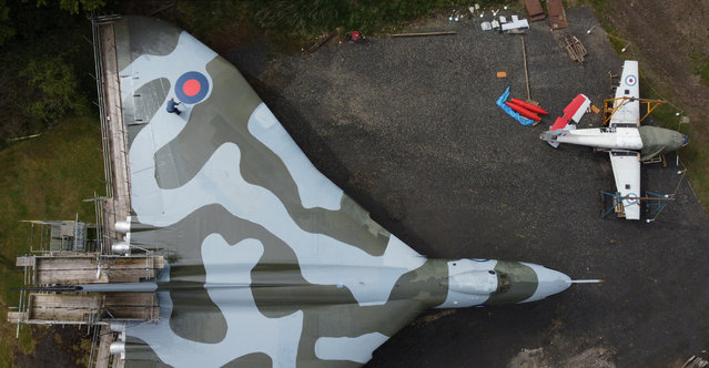 Dave Cook, volunteer at the North East Land, Sea and Air Museum (NELSAM), tends to the Vulcan bomber on display ahead of the venue's reopening to the public following the easing of COVID-19 restrictions, in Sunderland, Britain on May 15, 2021. (Photo by Lee Smith/Reuters)