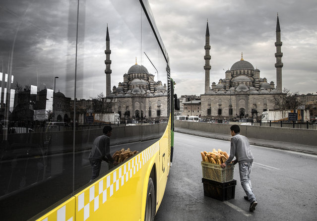 """Bread"". The photo was taken in Eminönü square which one of the largest squares in İstanbul. There are two images reflected from the bus glass. One of them is a boy who distributes bread to groceries, the other one is historical ottoman mosque. This is a souvenir photo that couldn't encountered in all the time. Photo location: Istanbul, Turkey. (Photo and caption by Sami Uçan/National Geographic Photo Contest)"