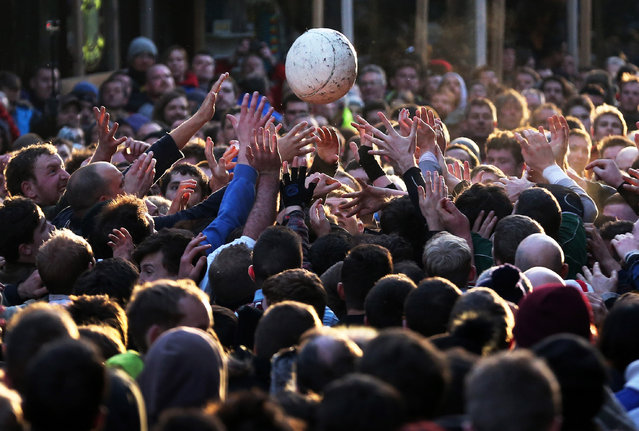 """Rival teams the """"Up'ards and Down'ards"""" battle for the ball during the annual Ashbourne Royal Shrovetide """"no rules"""" football match on February 9, 2016 in Ashbourne, England. Played since the 17th Century, the annual Shrovetide Football Match sees teams from opposite ends of the Derbyshire town of Ashbourne aim to get a ball into one of two goals that are positioned three miles apart at either end of Ashboune. (Photo by Christopher Furlong/Getty Images)"""