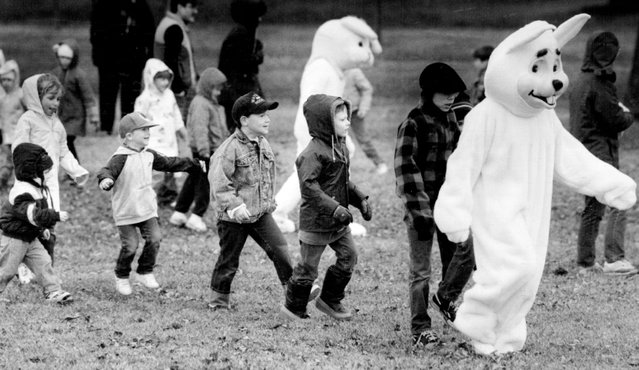 April 3, 1988: A bunny led children in a follow-the-leader game Saturday at Morris Baker Park Reserve. Some of the 1000 children who attended the Baker Park Reserve Easter Egg Hunt played follow the leader with several adults dressed in bunny suits. (Photo by Bruce Bisping/Minneapolis Star Tribune)