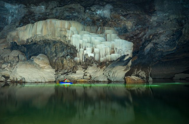Visitors to Tham Khuon Xe can rent canoes or kayaks and paddle upstream to view the stunning calcifications on the cave walls on March 2015 at Tham Khoun Ex, Laos. (Photo by John Spies/Barcroft Media/ABACAPress)