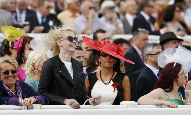 Horse Racing – Crabbie's Grand National Festival – Aintree Racecourse April 10, 2015: A racegoer celebrates during the 14:50 Betfred Mildmay Novices' Chase. (Photo by Andrew Boyers/Reuters)