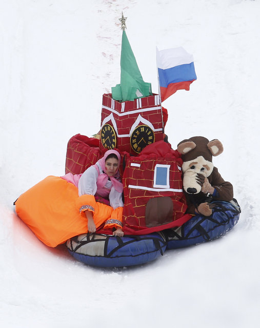 """Participants compete during a contest on the longest distance and the most creative performance at the """"Battle sani"""" (Sledge battle) festival of self-made sledges in Moscow, Russia, February 23, 2016. (Photo by Maxim Zmeyev/Reuters)"""