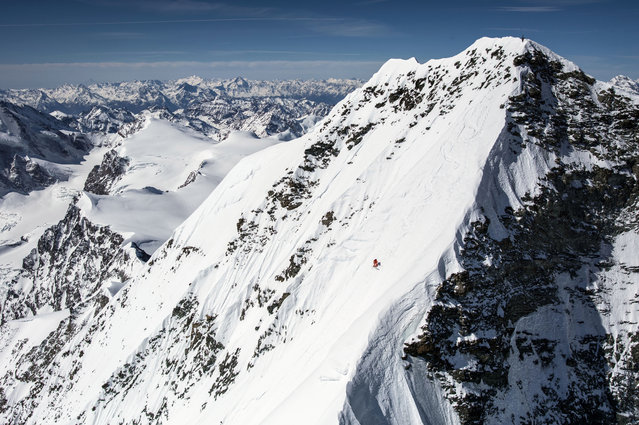 Gilles Sierro, professional Skier is the first ever person to ski down the dreaded sixty degree clifface of the Dent Blanche peak in Switzerland. (Photo by David Carlier/Caters News Agency)