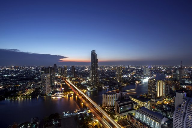 """Central Bangkok is seen from an abandoned skyscraper in Bangkok April 19, 2015. The abandoned building, known as Satorn Unique, dubbed the """"ghost tower"""" was destined to become one of Bangkok's most luxurious residential addresses but construction was never completed as the Thai economy was hit during the 1997 Asian Financial Crisis. Now, many travellers visit and explore 49-storey skyscraper. (Photo by Athit Perawongmetha/Reuters)"""