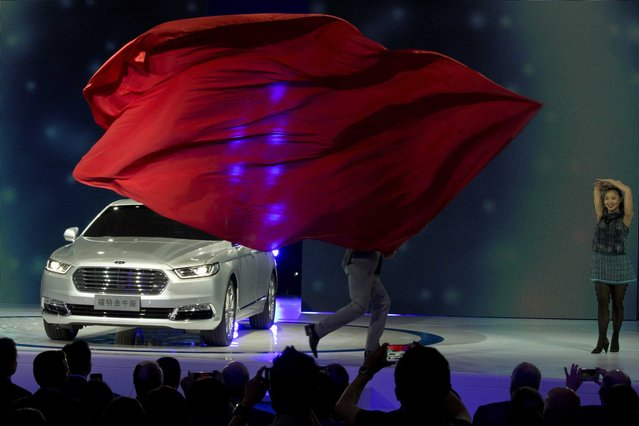 The Ford Taurus is unveiled during the opening of the Shanghai Auto Show in Shanghai, China, Monday April 20, 2015. (Photo by Ng Han Guan/AP Photo)