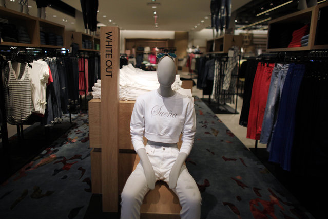 """In this Monday, March 23, 2015 photo, a mannequin wears a T-shirt with the Spanish word for """"Dream"""", at the Nordstrom luxury department store, two days before its opening in the newly built, The Mall of San Juan, in San Juan, Puerto Rico. (Photo by Ricardo Arduengo/AP Photo)"""