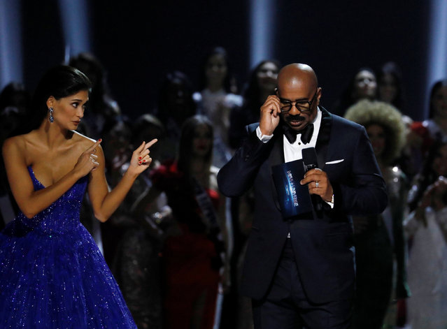 Outgoing Miss Universe Pia Wurtzbach gestures towards emcee Steve Harvey shortly before the winner of the 65th Miss Universe beauty pageant is announced at the Mall of Asia Arena, in Pasay, Metro Manila, Philippines January 30, 2017. (Photo by Erik De Castro/Reuters)
