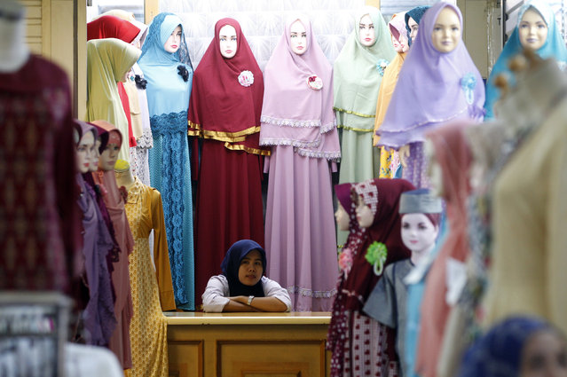 A vendor waits for customers at a clothing stall at the Tanah Abang mall in Jakarta, Indonesia March 11, 2016. (Photo by Garry Lotulung/Reuters)