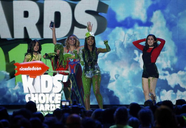 "The group Fifth Harmony is ""slimed"" while accepting the award for Favorite Music Group during Nickelodeon's 2016 Kids' Choice Awards in Inglewood, California March 12, 2016. (Photo by Mario Anzuoni/Reuters)"