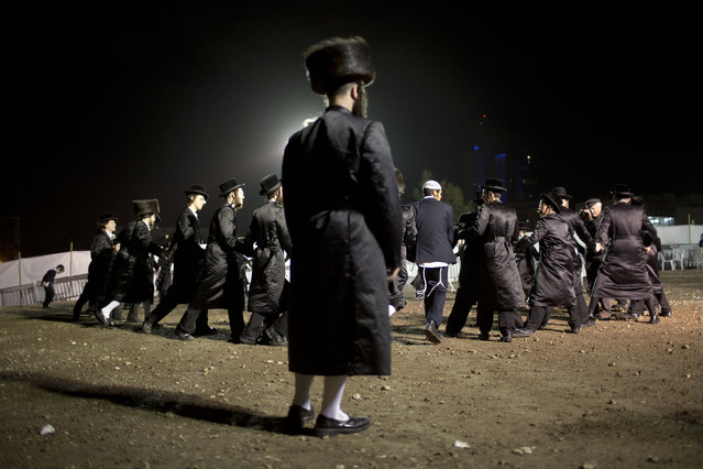 Ultra-Orthodox Jews dance in the men's section during the wedding of the grandson of the Rabbi of the Tzanz Hasidic dynasty community, in Netanya, Israel, Wednesday, March 16, 2016. (Photo by Oded Balilty/AP Photo)