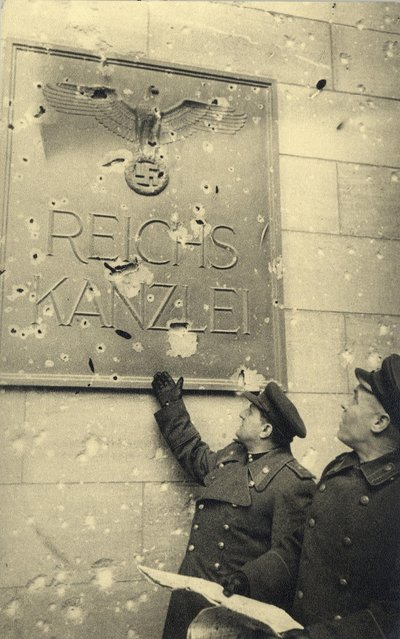 Russian soldiers stand next to a sign at an entrance of the Neue Reichskanzlei (New Reich Chancellery), the Chancellery of Adolf Hitler at Voss Street in this undated photo taken May 1945 in Berlin. (Photo by Georgiy Samsonov/Reuters/MHM)