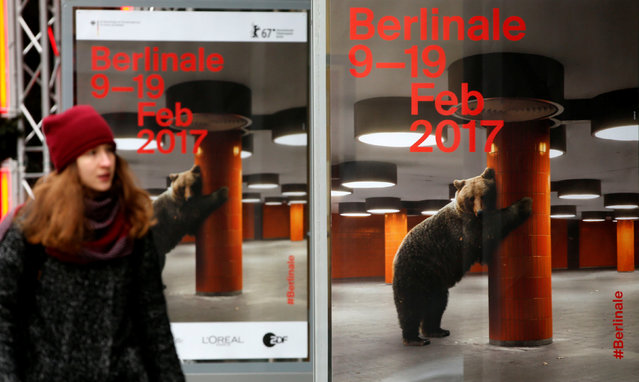 A pedestrian walks by advertising posters for the upcoming 67th Berlin International Film Festival Berlinale near the festival cinema in Berlin, Germany February 8, 2017. (Photo by Fabrizio Bensch/Reuters)