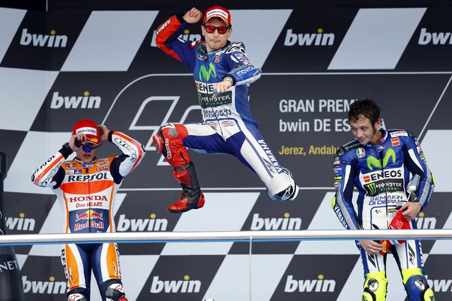 Yamaha MotoGP rider Jorge Lorenzo (C) of Spain celebrates between Honda rider Marc Marquez (L) of Spain and Valentino Rossi of Italy after winning the Spanish Grand Prix in Jerez de la Frontera, southern Spain, May 3, 2015. (Photo by Marcelo del Pozo/Reuters)