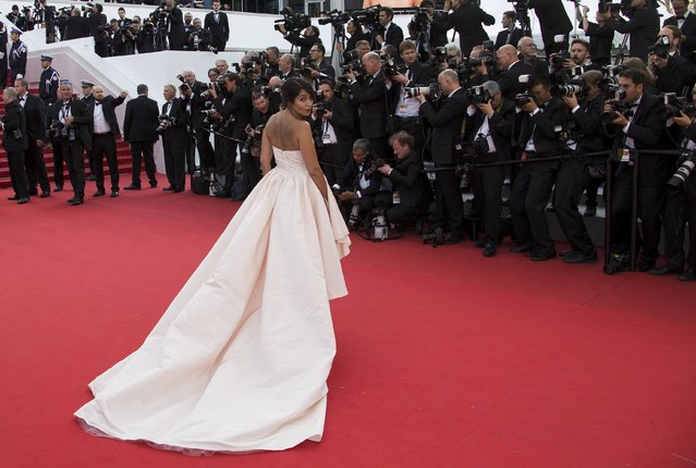"""Actress Leila Bekhti poses on the red carpet as she arrives for the opening ceremony and the screening of the film """"La tete haute"""" out of competition during the 68th Cannes Film Festival in Cannes, southern France, May 13, 2015. (Photo by Yves Herman/Reuters)"""