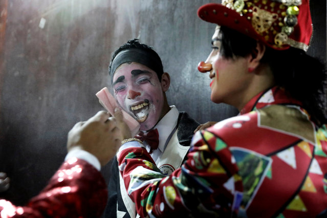 Clowns prepare to take part in a parade during Peru's Clown Day celebrations in Lima, Peru on May 25, 2019. (Photo by Guadalupe Pardo/Reuters)