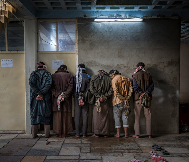 "Current affairs and news category, professional shortlist. ""Caught in the crossfire"". Iraqi men from the Hawija region wait to be questioned by Kurdish security personnel at a base near Kirkuk, Iraq. (Photo and caption by Ivor Prickett/2017 Sony World Photography Awards/Panos Pictures)"