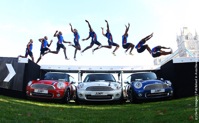 Current England long jump champion and London 2012 hopeful J. J. Jegede attempts an exhibition jump over three Limited edition 2012 MINIs