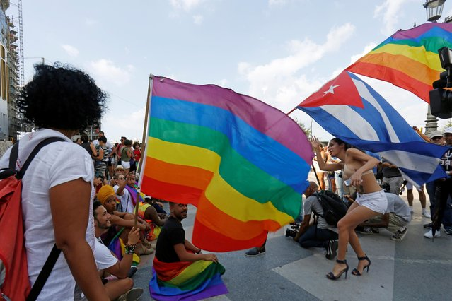 Cuban LGBT activists participate in an annual demonstration against homophobia and transphobia in Havana, Cuba on Saturday, May 11, 2019. The march was organized largely using Cuba's new mobile internet, with gay-rights activists and groups of friends calling for a march over Facebook and WhatsApp after the government-run gay rights organization cancelled a Saturday march. (Photo by Reuters/Stringer)