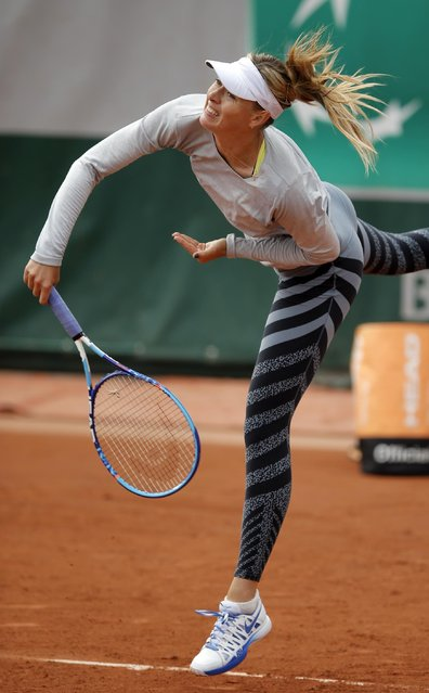 Defending champion Russia's Maria Sharapova practices during a training session for the French Tennis Open at the Roland Garros stadium, in Paris, Saturday, May 23, 2015. The French Open starts Sunday. (Photo by Francois Mori/AP Photo)