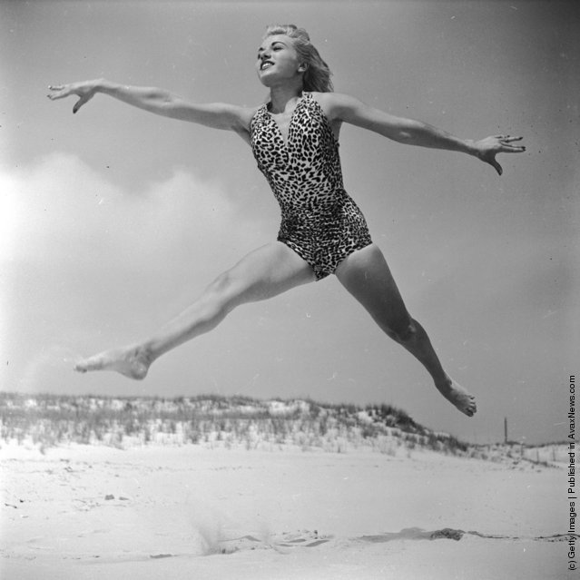 1950: Dancer Ann Argent practices her routine on the beach