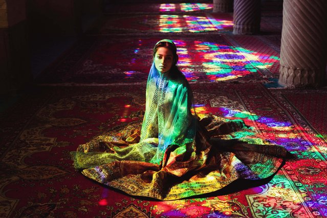 """""""Girl in a mosque"""". Photo made in Pink Mosque from Shiraz, Iran. The girl is wearing traditional persian outfit. Photo location: Shiraz, Iran. (Photo and caption by Mihaela Noroc/National Geographic Photo Contest)"""