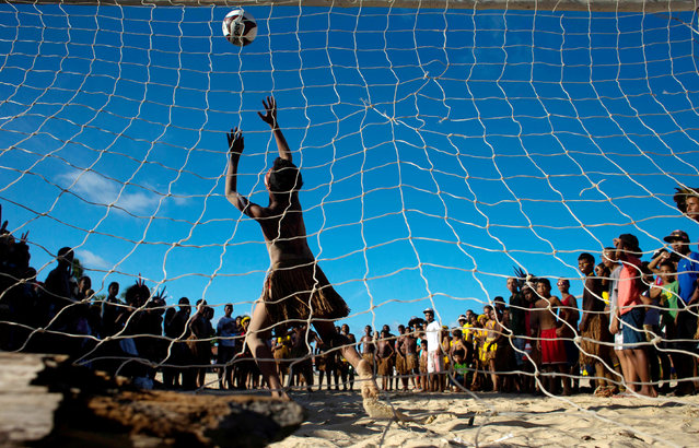 Native Brazilians play soccer, during the Indigenous Youth Games of Pataxos nation in Santa Cruz de Cabralia, Bahia state, Brazil, April 17, 2016. (Photo by Roosevelt Cassio/Reuters)