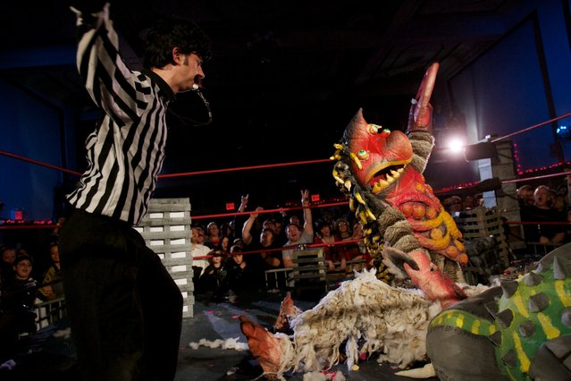 """A monster wrestling (""""Kaiju"""") bout ends suddenly as """"Giii the Space Pirate"""" pins """"Dusto Bunny"""" before a frenzied, sold-out crowd. (Photo by Sol Neelman)"""
