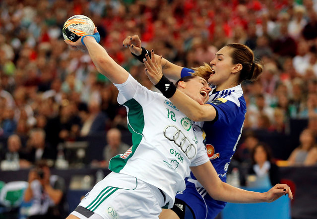 Eduarda Idalina Amorim of Hungary's Gyori Audi ETO KC fights for the ball with Kinga Acgruk of Montenegro's Buducnost during their Women's Handball Champions League semi final match in Budapest, Hungary May 7, 2016. (Photo by Laszlo Balogh/Reuters)