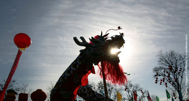 Athletes play a Dragon Dance during a new year temple fair held at the Longtan Lake Park