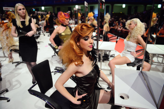 """Models styled by participants await judging during the contest """"Day style"""" of the OMC Hairworld World Cup on May 4, 2014 in Frankfurt am Main, Germany. (Photo by Thomas Lohnes/Getty Images)"""