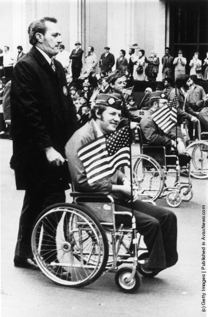 1973: Two amputees take part in a parade through Times Square in New York City, to commemorate the end of the Vietnam War and honour those who took part in it