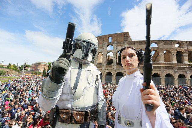 Star Wars fans dressed as a Clone Trooper and Princess Leila during the Star Wars Day 2014 at Colloseo on May 4, 2014 in Rome, Italy. (Photo by Ernesto Ruscio/Getty Images)