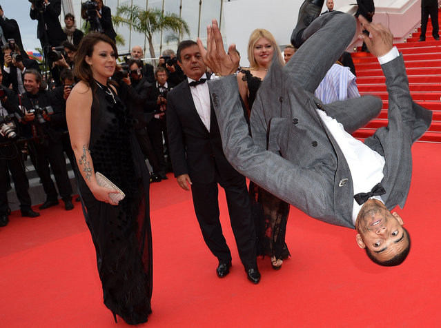 "French dancer Brahim Zaibat performs as he arrives for the screening of the film ""Foxcatcher"" at the 67th edition of the Cannes Film Festival in Cannes, southern France, on May 19, 2014. (Photo by Alberto Pizzoli/AFP Photo)"