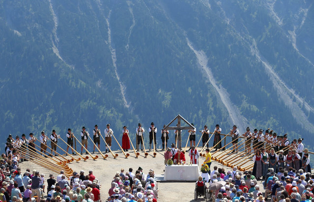 "Musicians of the alphorn group Euregio perform at the Fellhorn mountain near Oberstdorf, Germany, 19 July 2015. The 50 alphorn blowers accompanied the traditional ""Berglar-Kirbe"", a mountain mass in honour of Saint James, the patron of the alpine shepherds. (Photo by Karl-Josef Hildenbrand/EPA)"