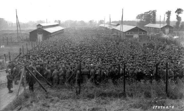 German prisoners of war captured after the D-Day landings in Normandy are guarded by U.S. troops at a camp in Nonant-le-Pin, France, August 21, 1944. REUTERS/US National Archives