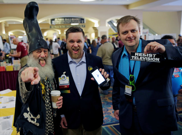 Libertarian Party candidate Vermin Supreme (L), wears his signature boot, with supporters at the National Convention held at the Rosen Center in Orlando, Florida, May 29, 2016. (Photo by Kevin Kolczynski/Reuters)
