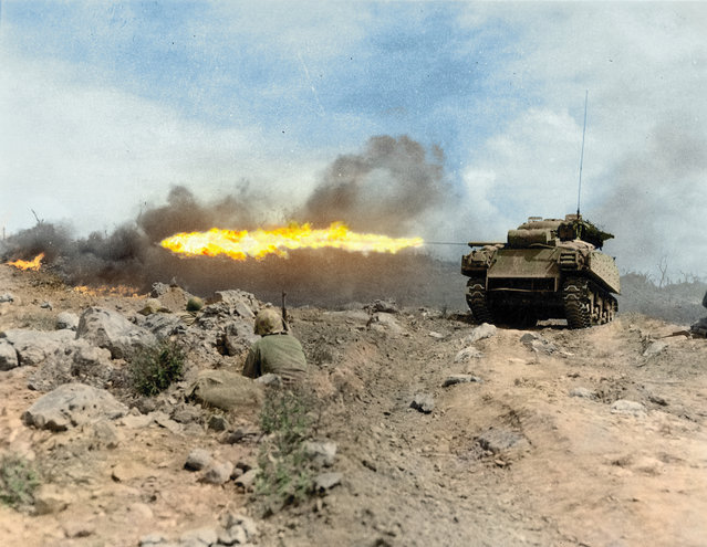 A Marine M4A3R3 flame-throwing tank goes into action, along with Marine snipers, as the battle for the possession of Iwo Jima rages on, March 1945. (Photo by Jared Enos/Mediadrumworld.com)
