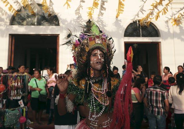 A man dressed as a Red Indian dances during celebrations honouring the patron saint of Managua, Santo Domingo de Guzman, in Managua, Nicaragua July 31, 2015. (Photo by Oswaldo Rivas/Reuters)