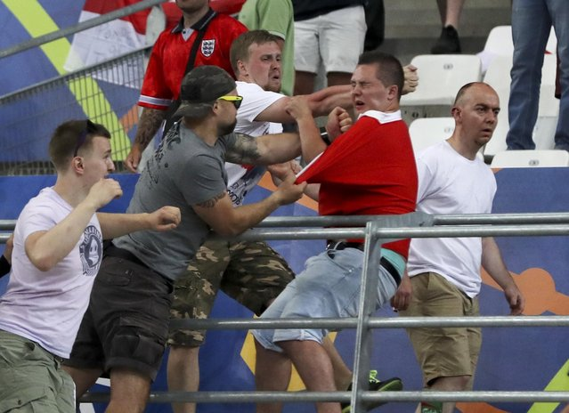 Clashes break out in the stands during the Euro 2016 Group B soccer match between England and Russia, at the Velodrome stadium in Marseille, France, Saturday, June 11, 2016. (Photo by Thanassis Stavrakis/AP Photo)