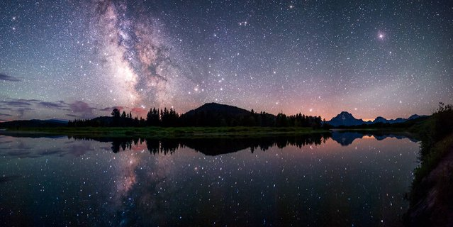 Oxbow Bend Reflections by David Kingham (USA). The Milky Way reflected in the Snake River at the famous Oxbow Bend in Grand Teton National Park. The galaxy is poised just above the horizon mimicking a glowing cloud. (Photo by David Kingham)