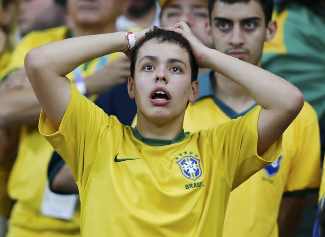 A fan of Brazil reacts during their 2014 World Cup semi-finals against Germany at the Mineirao stadium in Belo Horizonte July 8, 2014. (Photo by Marcos Brindicci/Reuters)