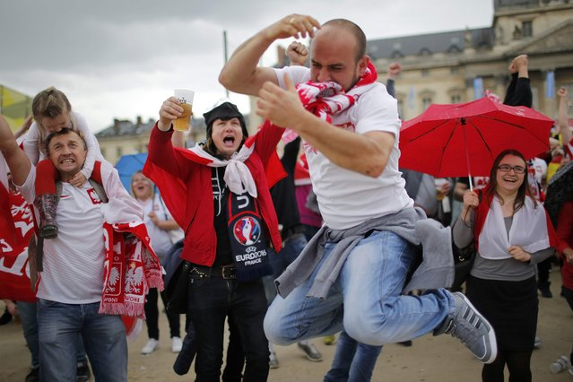 Football Soccer, Ukraine vs Poland, Euro 2016, Group C, Paris, France on June 21, 2016. Poland fans celebrate goal in fan zone. (Photo by Stephane Mahe/Reuters)