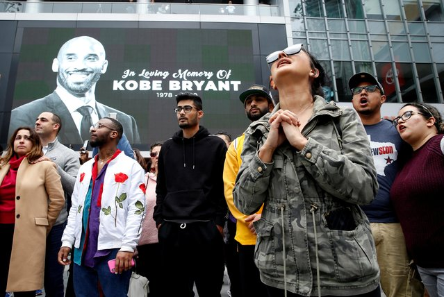 Mourners gather near an image of Kobe Bryant shown on a large screen outside the Staples Center after the retired Los Angeles Lakers basketball star was killed in a helicopter crash, in Los Angeles, California, U.S. January 26, 2020. (Photo by Monica Almeida/Reuters)