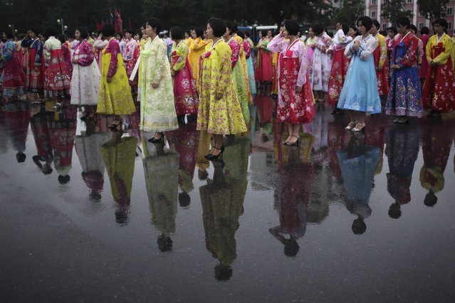 University students dressed in their traditional Korean dresses for the start of a mass dance on Thursday, July 27, 2017, in Pyongyang, North Korea as part of celebrations for the 64th anniversary of the armistice that ended the Korean War. (Photo by Wong Maye-E/AP Photo)