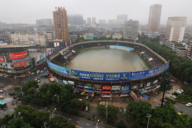 A stadium is flooded after heavy rainfall in Ezhou, Hubei Province, China, July 2, 2016. Picture taken July 2, 2016. (Photo by Reuters/Stringer)