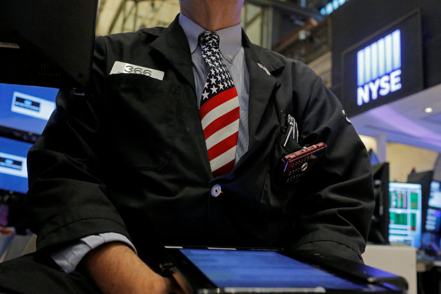 A trader works on the floor at the New York Stock Exchange (NYSE) ahead of the July 4 holiday weekend in New York City, New York, U.S., July 1, 2016. (Photo by Andrew Kelly/Reuters)