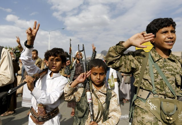 Armed boys join Houthi followers as they demonstrate against the Saudi-led air strikes in Yemen's capital Sanaa August 24, 2015. (Photo by Khaled Abdullah/Reuters)