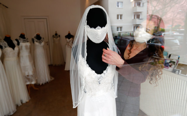 """Fashion designer and tailor Friederike Jorzig presents a face mask for wedding dresses in her shop """"Chiton"""", as the spread of the coronavirus disease (COVID-19) continues in Berlin, Germany, March 31, 2020. (Photo by Fabrizio Bensch/Reuters)"""